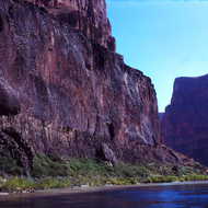 A wall of volcanic rock at river level in the Grand Canyon.