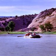 A private boat floats through Island Park in Dinosaur National Monument.