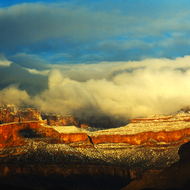 Sunset with clouds and snow in the heart of the Grand Canyon.