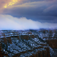 Sunset with clouds and snow on the South Rim of the Grand Canyon.