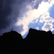 A silhouetted Mountain Goat as seen from the Colorado River in the Grand Canyon.