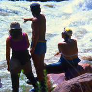 Rafters on a private trip scouting Crystal Rapid in the Grand Canyon.