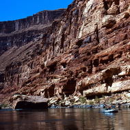 Boats passing by 10-mile rock on the Colorado River, approximately 10 miles down from put-in at Lee's Ferry.