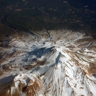 An aerial view of Mt. Shasta from a commercial airplane.