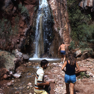 Rafters visiting the Stone Creek Waterfall near the Colorado River.