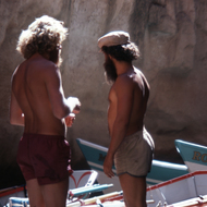 Raft guides admiring the brightly painted Grand Canyon Dories moored in Havasu Canyon.