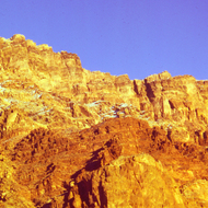 Moonset over Grand Canyon cliffs with a dusting of snow.