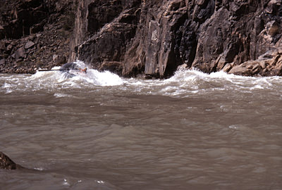 Thumbnail image ofA private rafter awash in a Granite Rapid wave.