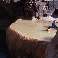 Whitewater rafters enjoying Pumpkin Hot Springs on the Colorado River in the Grand Canyon.