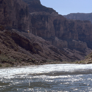 A helicopter flying down the Colorado River, probably in the 1970s or 1980s.