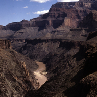 The Colorado River in the Grand Canyon with a slight dusting of snow on the rim.