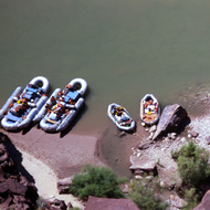Commercial and private boats tied up on the Colorado River at the Tapeats Creek confluence.