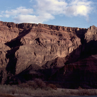 Cliffs beside the Colorado River as the sun begins to set.