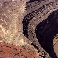 The geologic phenomenon that gives Goosenecks State Park its name.