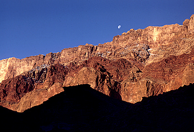 Thumbnail image of Moonset over a sunset-kissed cliff.
