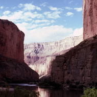 A view of the Grand Canyon from a riverside camp.