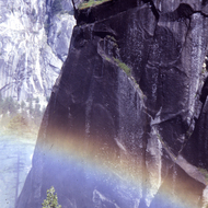 The mist from a Yosemite waterfall often causes rainbows.