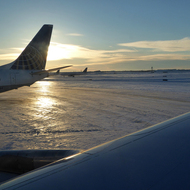 United Airlines jets at sunrise in the snow.