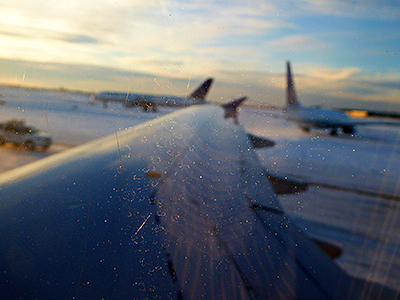 Thumbnail image of Ice crystals on the window of jet, as seen from...