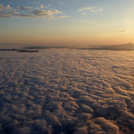 Sunrise over cloud cover from a commercial plane, the San Francisco Bay Area.