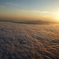 The sun rising over the San Francisco Bay Area as seen from a commercial jet.