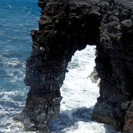 A sea arch of lava at Hawai'i Volcanoes National Park.