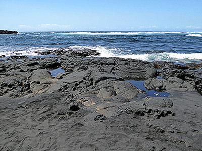 Thumbnail image ofLava at the sea at Punalu'u Black Sand Beach County...