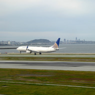 A United jet landing at San Francisco International Airport.