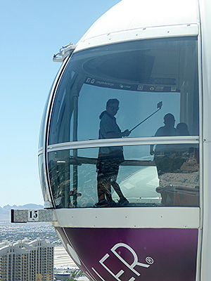 Thumbnail image ofA visitor taking a selfie in the High Roller observation...