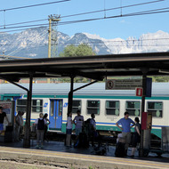 The train station in Bozen-Bolzano, Italy, with the Dolomites in the background.