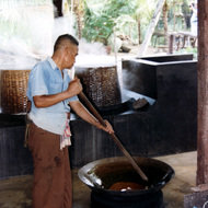 Thai man Cooking Coconut Sweets - Damnern Saduak, Thailand