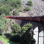 Bernina Express On Arched Bridge - Switzerland