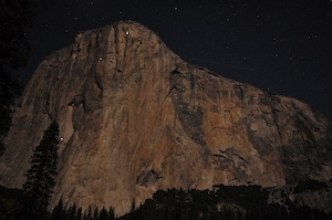 The face of El Capitan at night, with climbers bunked for
