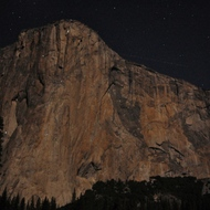 The face of El Capitan at night, with climbers bunked for the evening mid-way.
