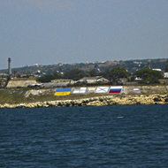 Flags of Russian and Ukrainian navy on shore.