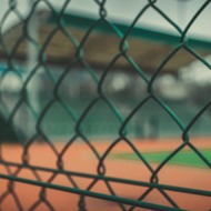 A tennis court fence.
