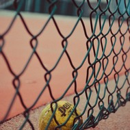 Tennis ball at the fence.