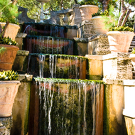 Waterfall in the main gardens of Vizcaya Museum and Gardens in Miami, Florida.