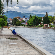 Fisherman on the Riverwalk beside Black Drin River.