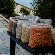 Nuts for sale along the Riverwalk beside the Black Drin River.