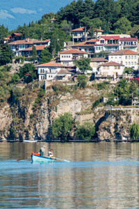 Thumbnail image ofFishermen on Lake Ohrid with the town of Ohrid...