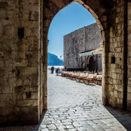 Archway leading to the plaza beside Dubrovnik Harbor.