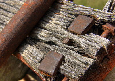 Thumbnail image of Rusty hand forged hardware on old wagon.