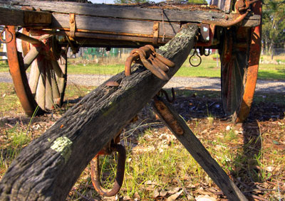 Thumbnail image of Weathered draw bar of old wagon.