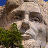 Lincoln represents preservation of the nation during the time of the Civil War.