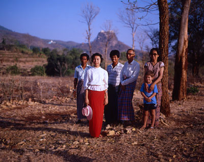 Thumbnail image ofFamily dressed in their finest about to visit...
