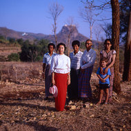 Family dressed in their finest about to visit Mount Popa.