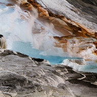 Colored cascading mineral laden hot water.