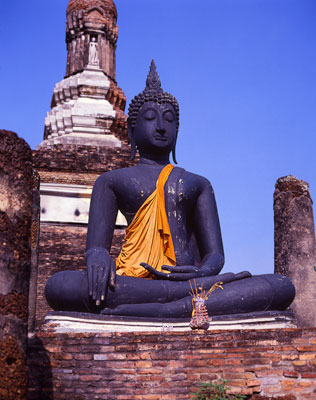 Thumbnail image ofBuddha stands out against the ruins of ancient...