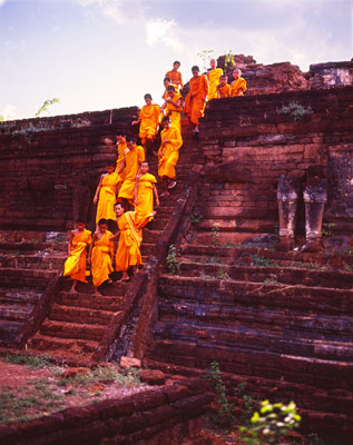 Thumbnail image ofYoung novice monks descend from the platform of...
